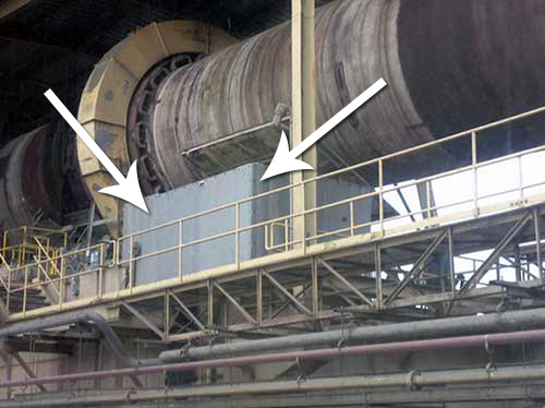 An outdoor enclosure shielding workers from hydraulic noise from a ball mill.